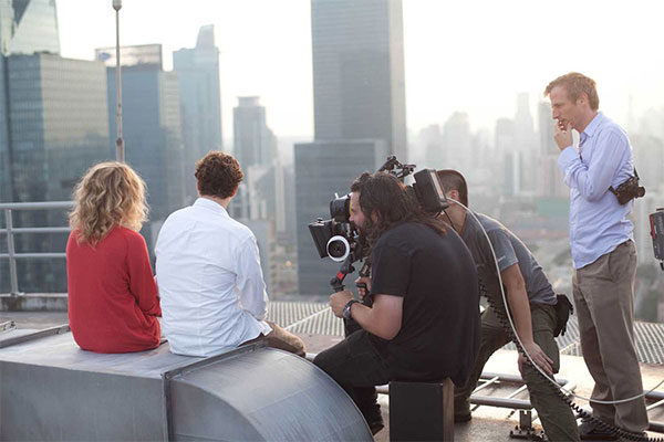 "Hoyte Van Hoytema (center) with Spike Jonze (right) on the set of ""Her."""